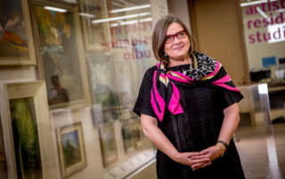 Judy Koke stands in front of case at Art Gallery of Ontario