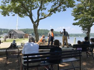 Three actors deliver a performance of Moby Dick at Mystic Seaport.